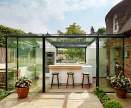Glass box extension on thatched cottage:  Kitchen units by Kitchen Architecture