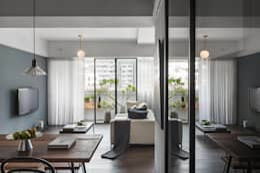 餐廳與廚房支間的拉門:  客廳 by 沐光植境設計事業