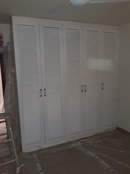 Hinged door louvered wardrobe installed by Zenia: country Bedroom by zenia