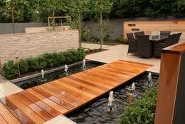 Jardines de estilo moderno por Hannah Collins Garden Design