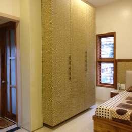wardrobe: modern Bedroom by Geometrixs Architects & Engineers