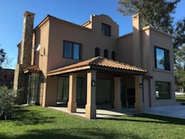 CASA EN SAINT THOMAS CC: Casas unifamiliares de estilo  por Estudio Dillon Terzaghi Arquitectura