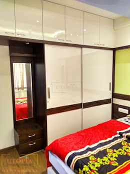 Bedroom Wardrobe: modern Bedroom by Utopia Interiors & Architect