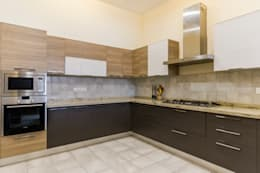 three tone kitchen: modern Kitchen by NVT Quality Build solution