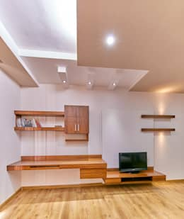 Tv unit with study ledge in bedroom: modern Bedroom by NVT Quality Build solution