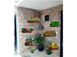 Jardineras: Paredes y pisos de estilo ecléctico por Vida Verde