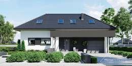 Maisons de style de style Moderne par HomeKONCEPT | Projekty Domów Nowoczesnych