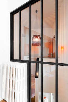 duplex : Murs de style  par la beau d'architecture