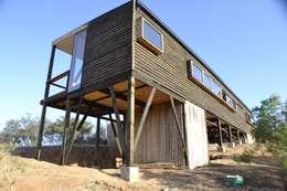 Vista poniente: Casas de estilo moderno por PhilippeGameArquitectos