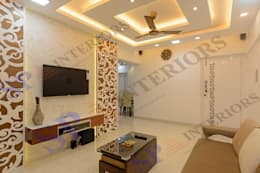 Mr. Rikin : classic Living room by SP INTERIORS