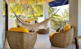 Terraza tropical en ratan: Terrazas de estilo  por Remodelar Proyectos Integrales