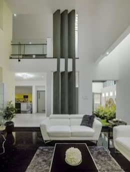 Striking House Interior Designs: 40×60, 4BHK: asian Living room by M/S Ashwin Architects