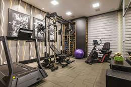 Residencia Renaiscense: Fitness  por TRÍADE ARQUITETURA