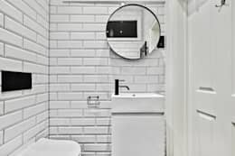 Baños de estilo moderno por BathroomsByDesign Retail Ltd