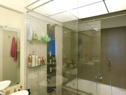Interior: modern Bathroom by Inspire Interiors & Archcons India Pvt Ltd