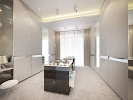 Walk-in closet: modern Dressing room by Dessiner Interior Architectural