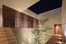 HNN HOUSE: Paredes de estilo  por Hernandez Silva Arquitectos