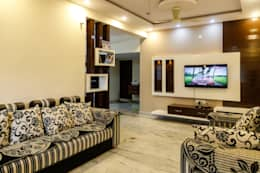 Mr. KoteshwarRao Uppal: modern Living room by Ghar Ek Sapna Interiors