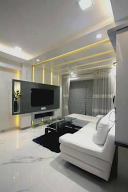 MR.KISHOR BHANUSHALI: modern Living room by PSQUAREDESIGNS