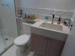 Banheiro Apartamento no Taquaral: Banheiros modernos por Ambiento Arquitetura