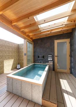 旅館の様な浴室は、テラスと一体になります。夜は天窓から星を眺めながら。: Lods一級建築士事務所が手掛けた浴室です。