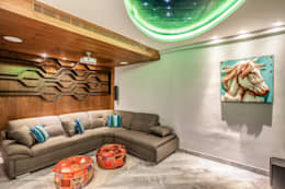 The mural apartment: tropical Media room by S Squared Architects Pvt Ltd