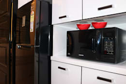 Tall unit with Microwave:  Built-in kitchens by Enrich Interiors & Decors