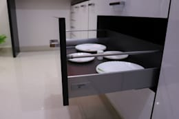 Pull Out accessories:  Built-in kitchens by Enrich Interiors & Decors