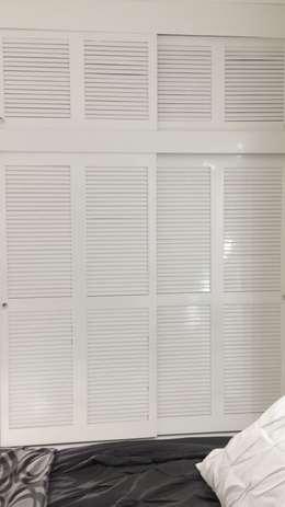 Closet: Recámaras de estilo moderno por Maref Arquitectos