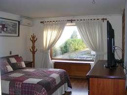 Dormitorio 3: Dormitorios de estilo colonial por Casabella