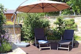 Faszination Gartenteich - modern und verspielt: ausgefallener Garten von RAUCH Gaten- und Landschaftsbau GbR