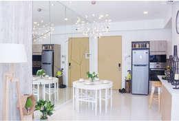 Vách tường bằng kính tạo hiệu ứng không gian khiến căn phòng rộng rãi hơn.:  Phòng ăn by Công ty TNHH Thiết Kế Xây Dựng Song Phát