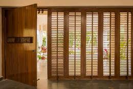 THE COURTYARD HOUSE:  Doors by CARTWHEEL