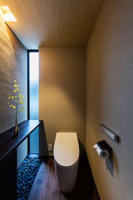 和のトイレ: SQOOL一級建築士事務所が手掛けた浴室です。