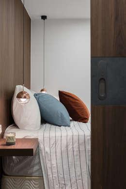 6+1 Pets house:  臥室 by 知域設計