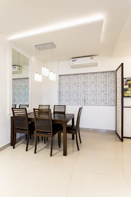 kandivili residence: modern Dining room by Rennovate Home Solutions pvt ltd