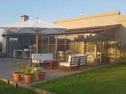 Galeria transformada en jardin de invierno: Jardines de invierno de estilo clásico por Estudio Dillon Terzaghi Arquitectura