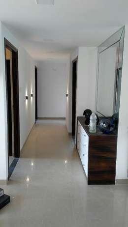 Mr. Udaybhan Singh Thakur Retirement Home:  Corridor & hallway by al-Haadi Interiors