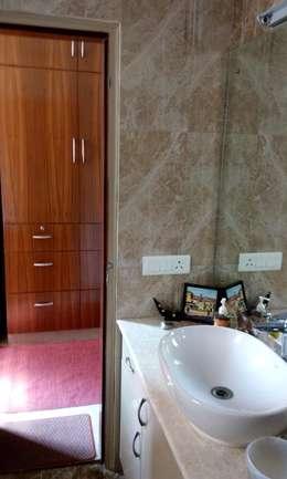 Old flat renovation: modern Bathroom by Rennovate Home Solutions pvt ltd