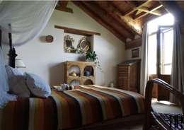 Decoración Casa Claudia: Dormitorios de estilo rural de RR Estudio Interiorismo