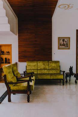 Lounge:  Corridor & hallway by Geometrixs Architects & Engineers