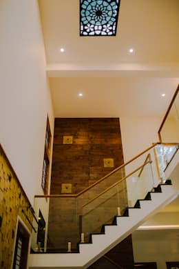 Stairs wall Cladding:  Stairs by Geometrixs Architects & Engineers