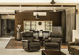 living area and dining area: modern Living room by Design Paradigm