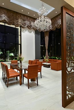 DIVYA BUNGALOW: modern Dining room by smstudio