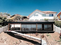 FACHADA PRINCIPAL: Casas de estilo moderno por arquiroots