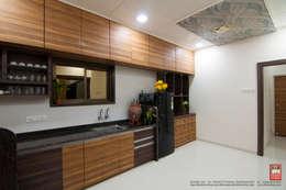 Interior of Residence for Mr. Chandrashekhar R: minimalistic Kitchen by ABHA Design Studio
