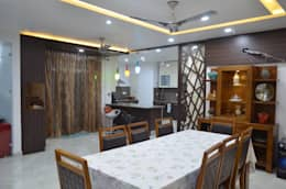 CLASSY DUPLEX HOUSE: modern Dining room by Vdezin Interiors