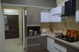 Stylish Apartment: modern Kitchen by Vdezin Interiors