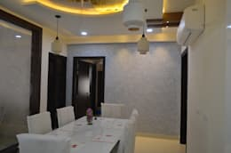 A SUMPTUOUS 3 BHK APARTMENT: modern Dining room by Vdezin Interiors