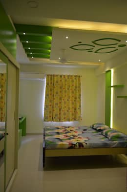 A SUMPTUOUS 3 BHK APARTMENT: modern Bedroom by Vdezin Interiors